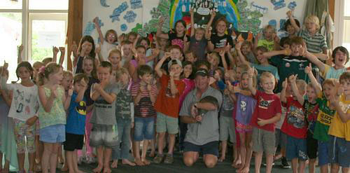 Todd and Kiwi with kids at Whangarei Heads Primary School